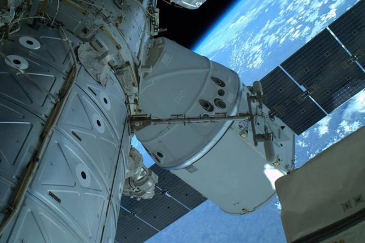 Image of SpaceX Dragon at the station taken by Astronaut Rick Mastracchio during spacewalk.