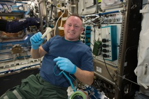 "International Space Station Commander Barry ""Butch"" Wilmore shows off a ratchet wrench made with a 3D printer aboard the orbiting lab. The wrench and other parts will return to Earth for comparison with ground samples in early 2015. Credit: NASA"
